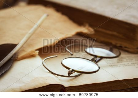 vintage glasses and quill pen