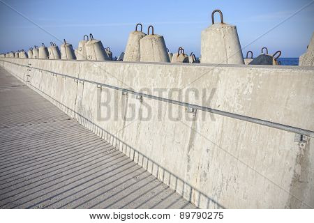 Sea Pier And Concrete Block Breakwaters.
