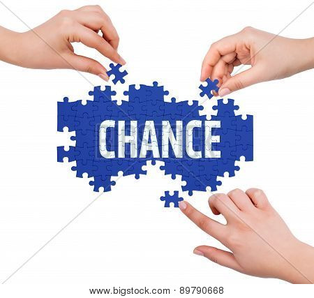 Hands With Puzzle Making Chance Word  Isolated On White