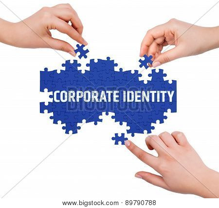 Hands With Puzzle Making Corporate Identity Word  Isolated On White