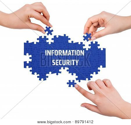 Hands With Puzzle Making Information Security Word  Isolated On White