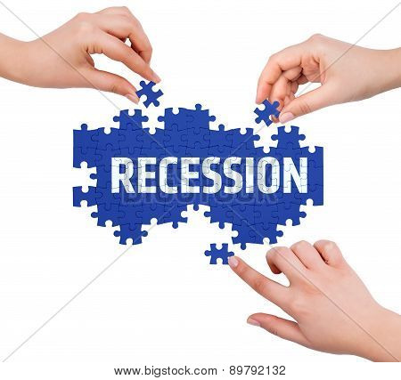 Hands With Puzzle Making Recession Word  Isolated On White