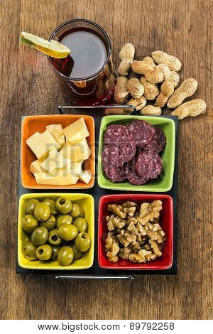 Glass Of Vermouth With Cheese, Olives , Salami, Nuts And Peanuts