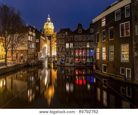 Amsterdam Canals and Saint Nicholas church at dusk Natherlands