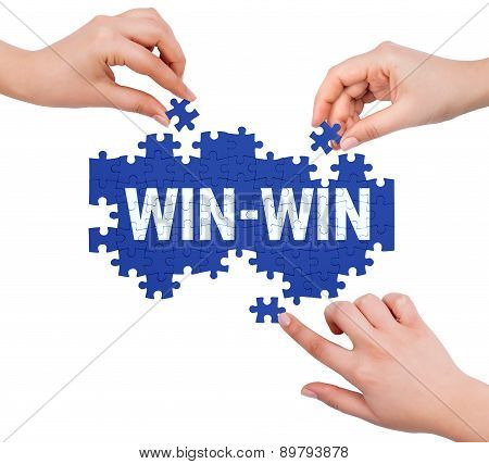 Hands With Puzzle Making Win-win Word  Isolated On White