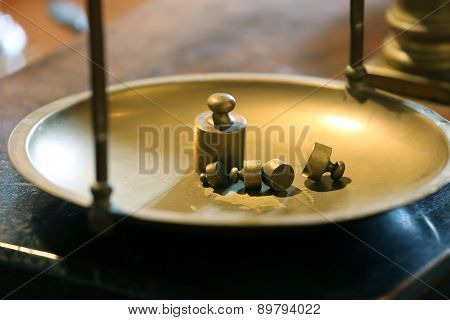 Ancient Brass Precision Scales With Weights Above The Balance Pan