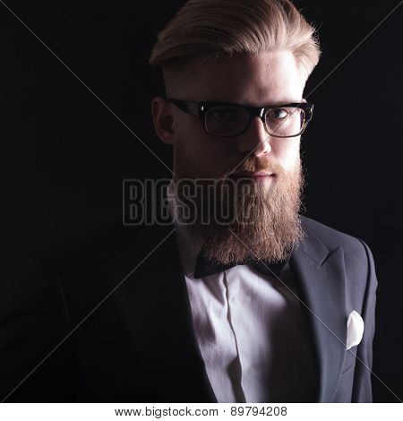 Close up picture of a blond business man looking at the camera.
