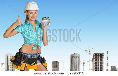 Smiling young woman in hard hat holding calculator