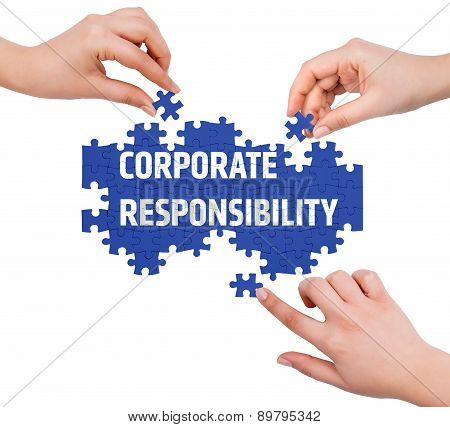 Hands With Puzzle Making Corporate Responsibility Word  Isolated On White