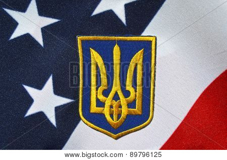 Ukrainian military chevron. With US Flag as background.on April 16,2015 in Kiev, Ukraine