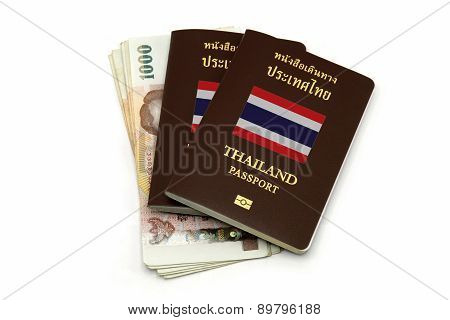 Thailand Passport And Thai Money For Travel Or A.e.c. Concept