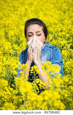 Young woman in a field has hay fever