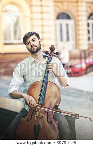 guy who plays the cello at  street in summer