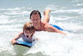 Young Father And Son Learning To Surf