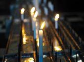 stock photo of prayer  - Christian Church Votive candles lit as prayer  - JPG