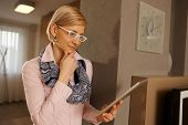 pic of concentration  - Blonde businesswoman using tablet computer at home - JPG