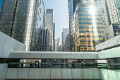 foto of hong kong bridge  - Abstract futuristic cityscape view with modern skyscrapers and people walking on bridge - JPG