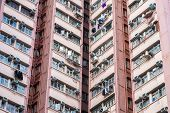 stock photo of overpopulation  - Abstract city background. Apartment building in Hong Kong ** Note: Visible grain at 100%, best at smaller sizes - JPG