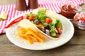 stock photo of tacos  - Mexican food Taco in plate on wooden table - JPG