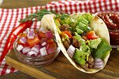 picture of tacos  - Mexican food Taco on wooden cutting board - JPG