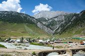 stock photo of jammu kashmir  - scenic view of village in Sonamarg Jammu and Kashmir state India among mountain range and river - JPG