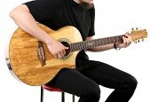 stock photo of acoustic guitar  - Young man playing on acoustic guitar isolated on white - JPG