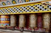 pic of sanskrit  - Buddhist prayer wheels with words engraved in a monastery - JPG