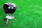 foto of charcoal  - BBQ Charcoal Grill Appliance On The Lawn Background With Copy Space - JPG