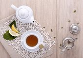 stock photo of hot-water-bag  - teapot with cup of tea - JPG
