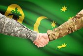 image of coco  - Soldiers shaking hands with flag on background  - JPG