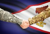 pic of samoa  - Soldiers shaking hands with flag on background  - JPG