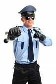 picture of policeman  - Policeman in sunglasses shows on you with nightstick - JPG