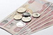 picture of dirhams  - One hundred Dirham currency notes and coins on white background - JPG