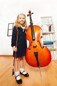 picture of hair bow  - Small blond girl with curly hair holding the fiddle - JPG