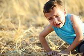 stock photo of muslim kids  - Kid crying on field - JPG
