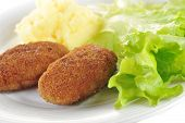foto of pork cutlet  - roasted cutlets of pork with potato and lettuce - JPG