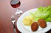 foto of pork cutlet  - roasted cutlets of pork with potato and wine - JPG