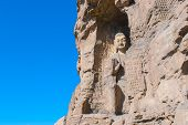 foto of stone sculpture  - stone Buddha sculpture in the cave in Shanxi - JPG