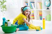 stock photo of cleanse  - Cute kid little girl cleanses a floor in children room - JPG