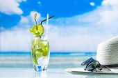 foto of cocktail  - Mojito cocktail with fresh lime at the beach - JPG