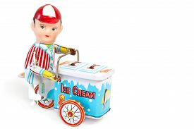 pic of tin man  - Toy ice man with cart on white background - JPG