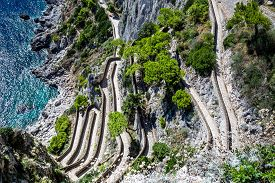 stock photo of twisty  - Patch on a Capri island in a beautiful summer day in Italy - JPG