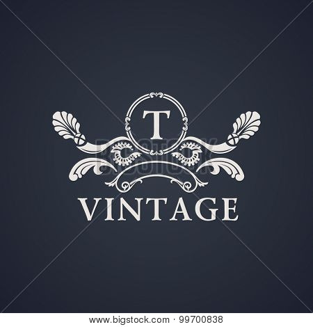 Vintage luxury emblem. Elegant Calligraphic pattern on vector logo. Black and white monogram T