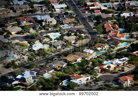 Homes houses from high overhead aerial neighborhood development swimming pools and streets