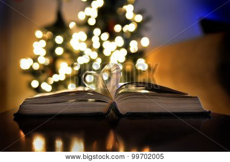 Open book with Christmas lights love of reading and learning