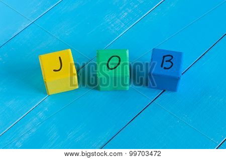 Word Job on children's colourful cubes or blocks - educational background for teaching.