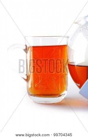 black tea in glass and kettle on white