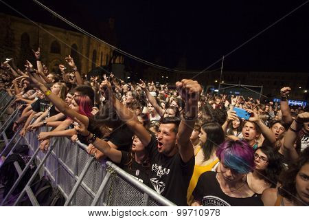 Cluj-Napoca, Romania - August 2, 2015: Cheering crowd on hard rock band, Altar`s live concert at the Untold Festival