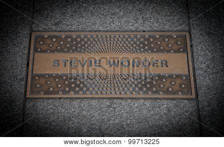 NEW YORK CITY, USA - SEPTEMBER, 2014: Stevie Wonder paving slab in front of famous Apollo thetare in Harlem New York City