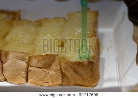 Butter And Sweetened Milk On Top The Toast